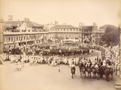 Wrestling matches in old Rajwada, [Kolhapur, watched by large crowds].